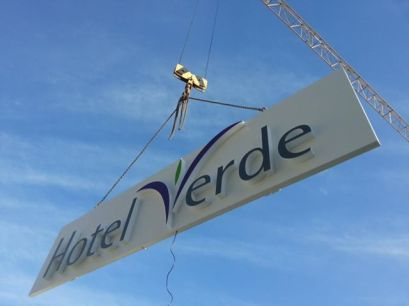 The Hotel Verde name sign being installed